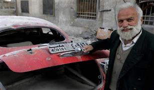 بالصور.. مالك سيارات الرؤساء في حلب السورية يبكي علي ما أصابها في الحرب