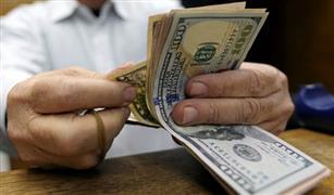اليوان الصينى يرتفع قليلا و الدولار يواصل مفاجأته  فى تعاملات الأربعاء